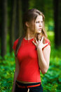 Worried woman in a forest Royalty Free Stock Images
