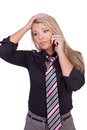 Worried woman listening to her mobile phone Royalty Free Stock Photo