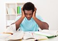 Worried young african man studying Royalty Free Stock Photo
