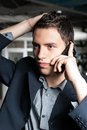 Worried young business man talking on a phone Stock Images