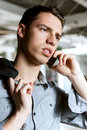 Worried young business man talking on a phone Royalty Free Stock Photos