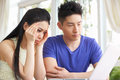 Worried Young Chinese Couple Using Laptop Royalty Free Stock Images
