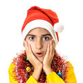 Worry expression boy santa claus with a dressed in red and white hat and christmas decorations isolated on white background Stock Image
