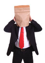 Worrying business man with a paper bag on head isolated white Stock Photo