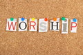 Worship the word in cut out magazine letters pinned to a cork notice board Royalty Free Stock Photos