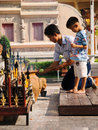 Worshiping buddha thailand chiang mai march thai people kneeling on the ground in front of a small temple in chiang mai Royalty Free Stock Image