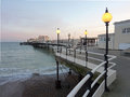 Worthing pier at dusk uk the the south coast resort of sussex people are fishing from the Royalty Free Stock Photography
