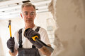 Worthy senior man working with hammer and tool while demolish wa Royalty Free Stock Photo