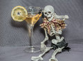 Would you like to drink and drive or you like to joying the life a skeleton sitting near glass with alcohol fluid looking at car Royalty Free Stock Image