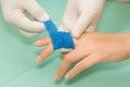 Wound dressing appy medicine buddy bandage on finger injury Stock Photos