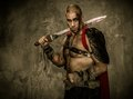 Wounded gladiator holding sword with covered in blood Royalty Free Stock Images