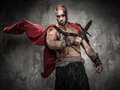 Wounded gladiator with sword covered in blood Stock Photos