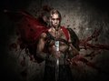 Wounded gladiator with sword holding covered in blood both hands Stock Photos