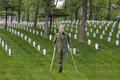 Wounded warrior combat veteran soldier hero sacrifice an army of war stands in a military cemetery where fellow soldiers paid the Royalty Free Stock Images