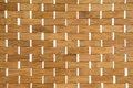 Woven bamboo mat background texture with white weave detail showing the natural fibers of the full frame Royalty Free Stock Images