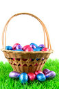 Woven basket with easter eggs on green grass Royalty Free Stock Photos