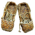 Woven bast sandals Royalty Free Stock Image