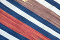 Woven cloth with color stripes as background fabric texture diagonal view closeup Stock Photo