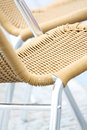 Woven straw chair bright view of an vertical selective focus Royalty Free Stock Photography