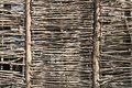 Woven from thin rods textured fence Royalty Free Stock Photo