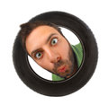 Wow expression in the car tire on white background Stock Photography