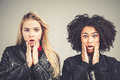 Wow Two surprised teenage hipster girls open mouth toching their faces Royalty Free Stock Photo