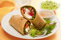 Wrap alternative taco or burrito which includes traditional sandwich fillings wrapped in a tortilla Royalty Free Stock Images