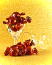 Wrapped chocolate candy in glass brown paper fancy glasses or stemware Stock Photos