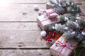 Wrapped christmas presents, fur tree branches, red berries on ag Royalty Free Stock Photo