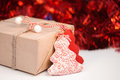 Wrapped gift box on red sparkling background a Royalty Free Stock Image