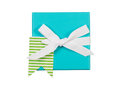 Wrapped Gift Box and White Ribbon Bow on White background Royalty Free Stock Photo