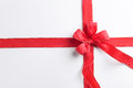 Wrapped gift with red ribbon Royalty Free Stock Image