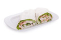 Wrapped sandwich with shrimp and lettuce over white background Stock Image