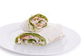 Wrapped sandwich with shrimp and lettuce over white background Royalty Free Stock Image