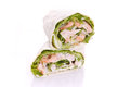 Wrapped sandwich with shrimp and lettuce over white background Royalty Free Stock Photo