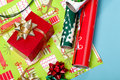 Wrapping paper, bows, and a red box Stock Photo
