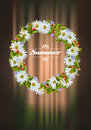 Wreath of camomile wild strawberries and bellflowers Royalty Free Stock Images
