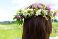 Wreath of flowers on womans head beautiful closeup young woman watching into the distance waiting for her young husband Royalty Free Stock Photography