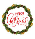 Wreath isolated over white background with text Merry Christmas. Calligraphy and lettering Royalty Free Stock Photo