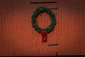 Holiday Wreath on red barn