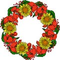 Wreath of red blossoming poppies, yellow sunflowers and green le