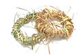 Wreaths made of straw isolated on white Stock Photos