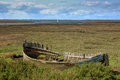 Wreck of an abandoned fishing boat on the blakeney marshes in norfolk england Royalty Free Stock Images