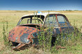 Wreck car in a field overgrown with weeds and forgotten Royalty Free Stock Photography