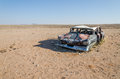 Wreck of classic saloon car abandoned deep in the Namib Desert of Angola Royalty Free Stock Photo