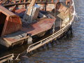 Wreck of fishing boat sunken in harbour Stock Image