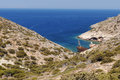Wreck on greek coastline scenic view of with of boat in small blue bay Stock Image