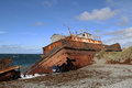 Wreck near punta arenas on a beach of straits of magellan Royalty Free Stock Photos
