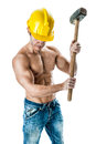 Wrecker a very muscular and handsome manual worker with a sludgehammer and a yellow helmet isolated over white Stock Photos
