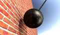 Wrecking ball hitting wall a regular metal attached to a chain and breaking a face brick Stock Photo